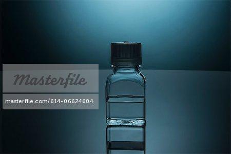 Glass bottle of clear liquid