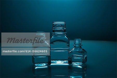 Glass bottles of clear liquid