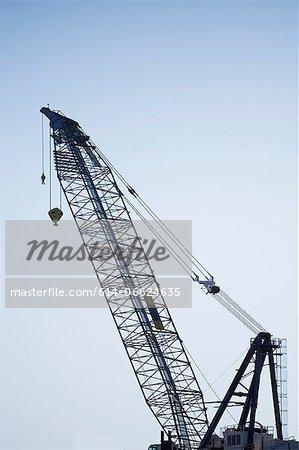 Silhouette of crane against sky