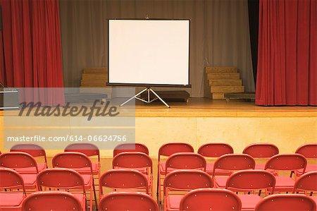 Blank screen in empty auditorium