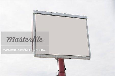 Blank billboard in cloudy sky