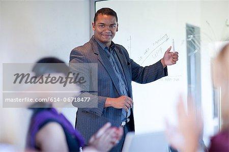 Businessman making graph on glass