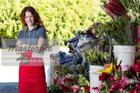 Florist smiling in shop
