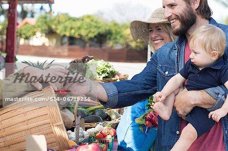 Family shopping at farmer's market