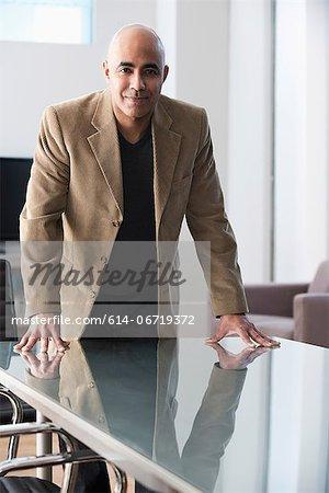 Businessman standing at conference desk