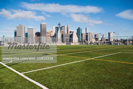 Soccer fields and Lower Manhattan skyline, New York City, USA