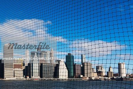 View of Manhattan skyline through netting, New York City, USA