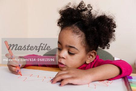 Girl drawing zig zag pattern