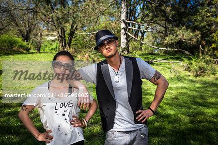 Couple wearing sunglasses, portrait