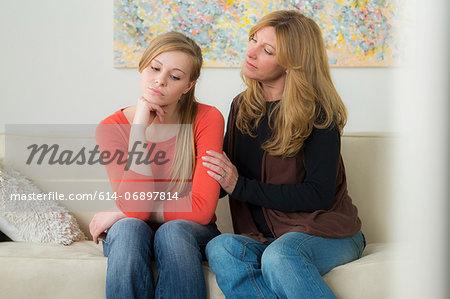 Mature woman comforting teenage daughter