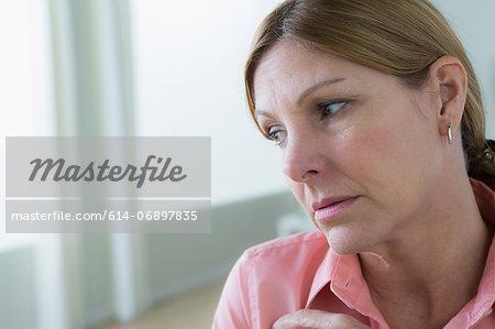Portrait of sad mature woman looking away