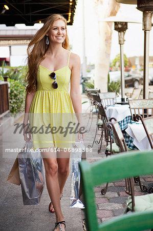 Woman shopper alongside pavement café