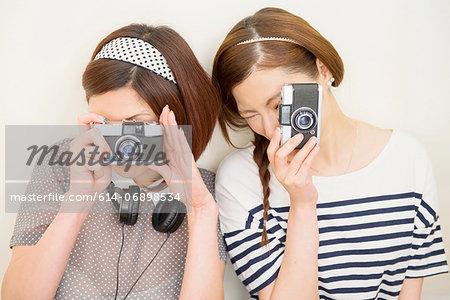 Two women taking photograph