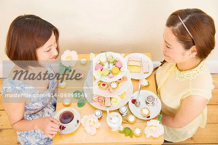 Two women having tea and teatime treats