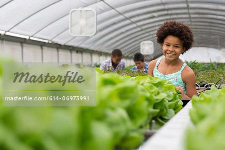Children tending plants in nursery
