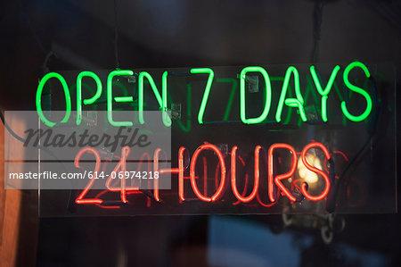 24 hour illuminated neon sign