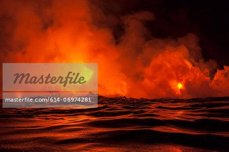 Lava flow into sea at night, Kilauea volcano, Hawaii