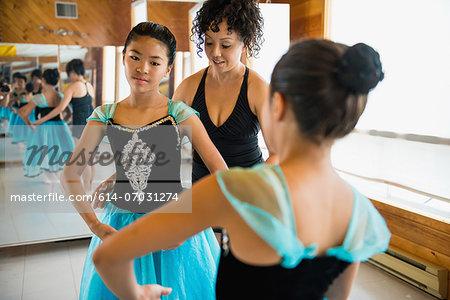 Mature woman teaching ballerinas
