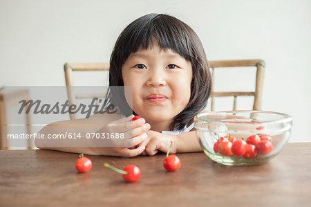 Girl eating cherries, portrait