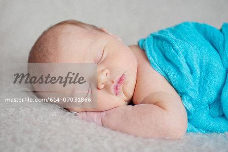 Baby boy's sleeping on blanket