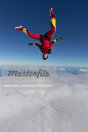 Female skydiver free falling upside down