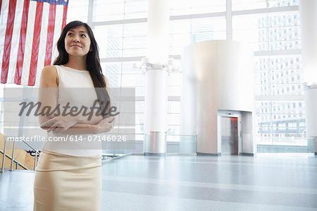 Businesswoman standing in Staten Island Ferry terminal