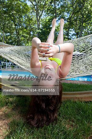 Girl in hammock using mobile phone