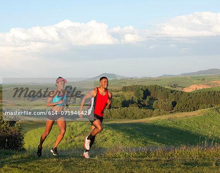 Young couple jogging in landscape, Othello, Washington, USA
