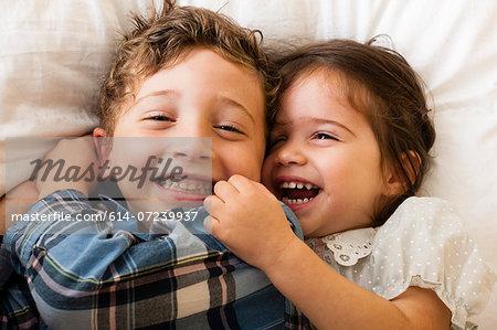 Children lying on bed