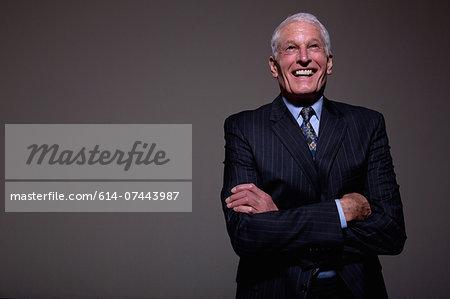 Studio portrait of senior man in suit