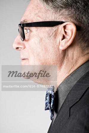 Portrait of senior man wearing bowtie, side view