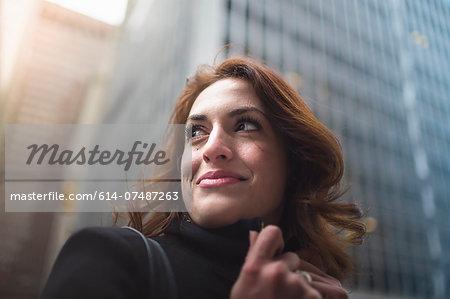 Young woman on street, New York, USA