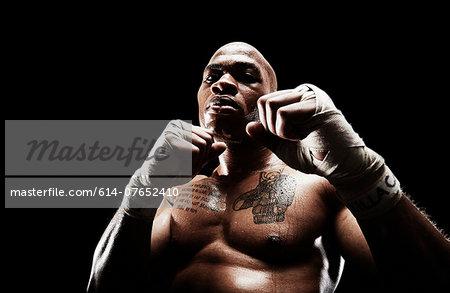 Mid adult man boxing