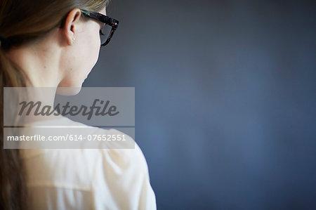 Young woman wearing glasses, studio shot