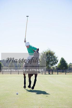 Mature man playing polo