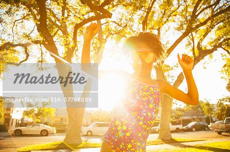 Girl in dancing in scuba goggles in garden
