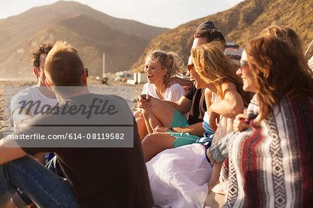Group of friends camping on beach, Malibu, California, USA