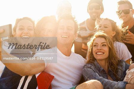 Group of friends taking selfie on beach