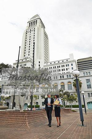 Business people walking across tiled floor, Los Angeles City Hall, California, USA
