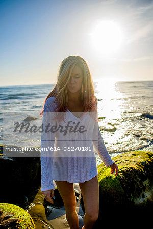 Woman enjoying beach, El Capitan, California, USA