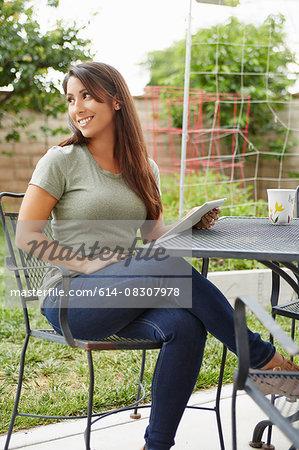 Woman using digital tablet in garden
