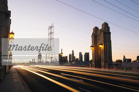 Light trails of traffic crossing 4th street bridge in the evening, Los Angeles, California, USA