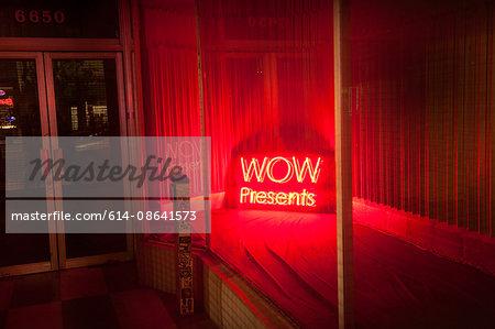 Illuminated sign in window, Los Angeles, California, USA
