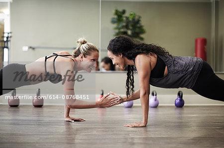 Women doing plank in gym