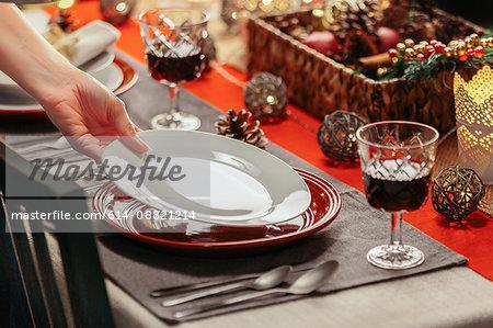 Woman preparing festive place setting
