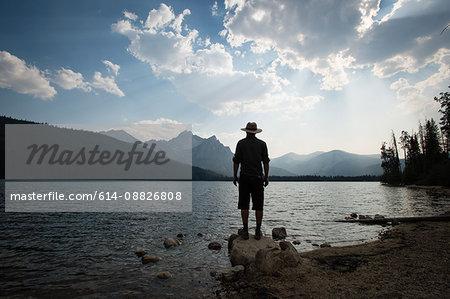 Rear view of man looking at view over Stanley lake, Idaho, USA