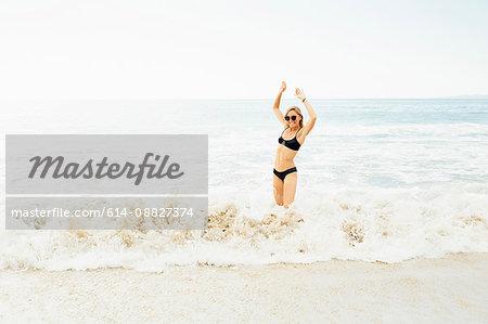 Woman wearing bikini standing in sea