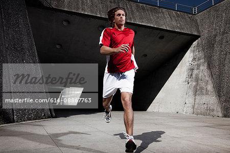 Man running on city street