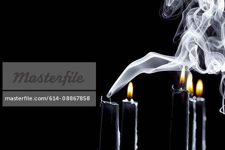 Close up of smoking black candle