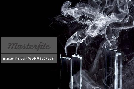 Close up of smoking black candles